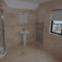 Tiled Marble and Mosaic Bathroom