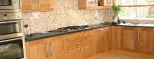 Marble tiled kitchen floor and kitchen wall