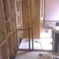 All tiles and timber paneling removed and some stud work cut out