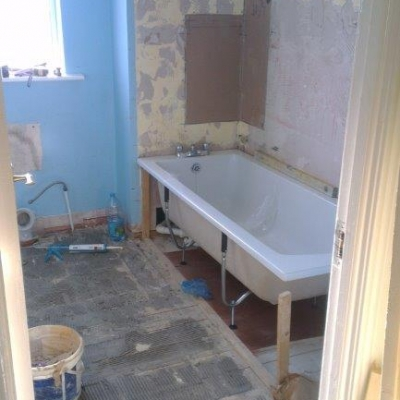 5. Refitting the bath and the replacing slabs