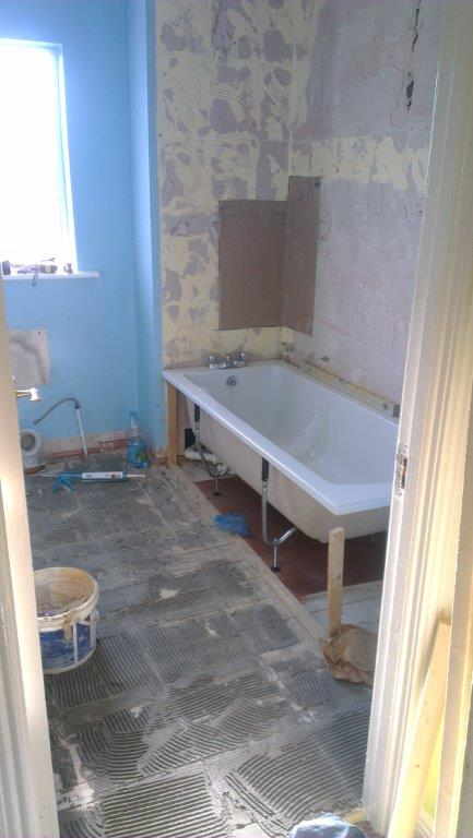 Fitting the new bath and the replacing slabs