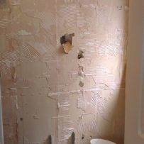 Damaged plasterboard from removing tiles