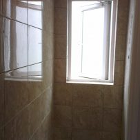 Tiling ensuite walls