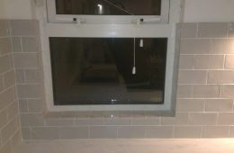 Window shelf tiled and grouted