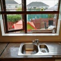Window shelf tiled and chrome trims used
