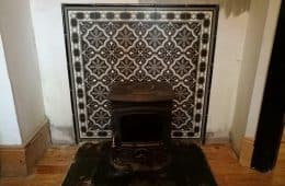 Pattern tiles behind a fireplace