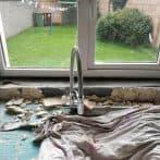 Water damaged plasterboard crumbling apart